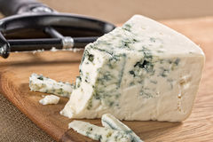 Slices of blue gorgonzola cheese on a board Stock Image
