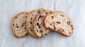 Slices of blueberry streusel bread on a marble cutting board Royalty Free Stock Images