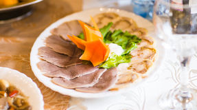 Slices of boiled beef tongue. On a festive table Royalty Free Stock Images