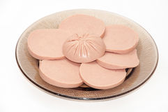 SLICES OF BOLOGNA ON THE PLATE Royalty Free Stock Photo