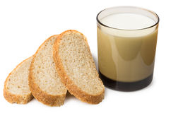 Slices of bran bread and glass of milk Stock Photography
