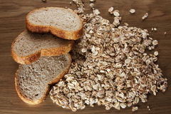 Slices of bran bread with oat flakes Royalty Free Stock Images