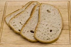 Slices of bread. Four fresh slices of bread Royalty Free Stock Photography