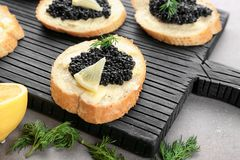 Slices of bread with black caviar Royalty Free Stock Photo