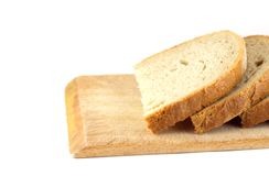 Slices of bread on board. (closeup, detail Royalty Free Stock Photo