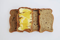 Slices of bread with butter and honey Royalty Free Stock Photography