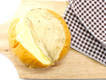 Slices bread with butter on a rustic wooden cutting board Royalty Free Stock Photos