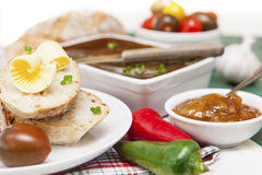 Slices of bread and butter with tomatoes, peppers, chutney and p Stock Image