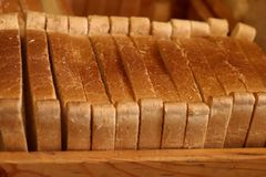 Slices of bread. The concept of nutrition, health. Background, cropped and blurred image of bread. royalty free stock photography