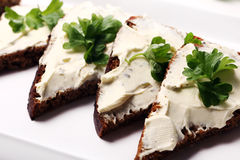 Slices of bread with cream cheese Stock Image