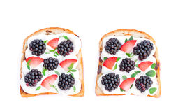 Slices of bread with cream cheese berries and basil isolated on Royalty Free Stock Photo