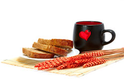 Slices of bread and cup. With a heart Royalty Free Stock Images