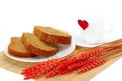 Slices of bread and empty cup. With a heart Royalty Free Stock Photo