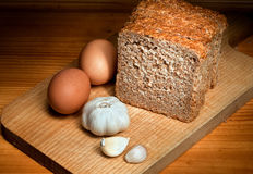Slices of bread, garlic and eggs Royalty Free Stock Image