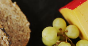 Slices of bread, grapes and cheese. On tray stock video footage