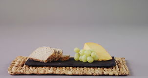 Slices of bread, grapes and cheese. On tray stock footage