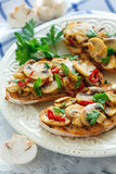 Slices of bread grilled with fried mushrooms and onions. Stock Images
