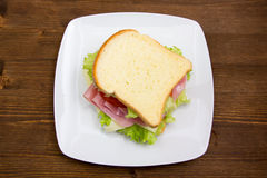 Slices of bread with ham and salad on wood from above Stock Image