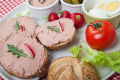 Slices of bread with home made pate, decorated with vegetables Stock Photo