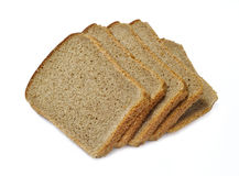 Slices of bread isolated. Slices of dark bread isolated over white stock images