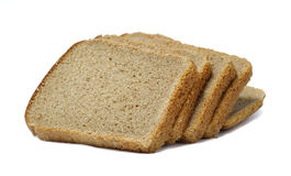 Slices of bread isolated. Slices of dark bread isolated over white Royalty Free Stock Photo