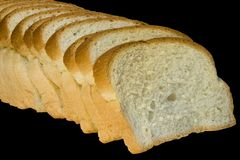 Slices of bread isolated on black. Background with clipping path Royalty Free Stock Photos
