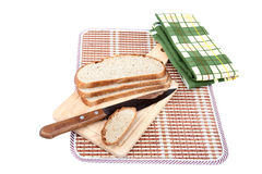 Slices of bread with  knife chopping board Stock Photography