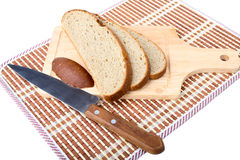 Slices of bread  knife chopping board Stock Photo