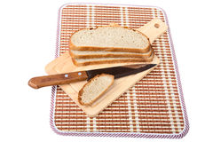 Slices of bread  knife chopping board isolated Royalty Free Stock Photo