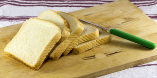 Slices of Bread and Knife Royalty Free Stock Photo