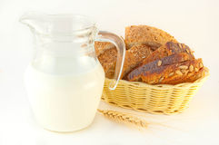 Slices of bread and milk Stock Photography