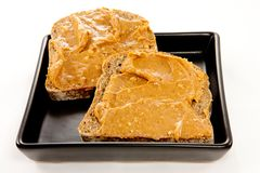 Slices of bread with peanut butter Royalty Free Stock Photos