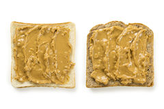 Slices of bread with peanut butter. Photo of two slices of white and whole wheat bread covered in peanut butter, isolated on white Stock Image