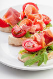 Slices of Bread with Spanish Serrano Ham Stock Images