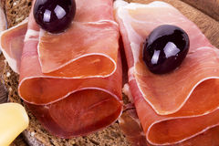 Slices of bread with spanish serrano ham Stock Photography
