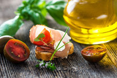 Slices of Bread with Spanish Serrano Ham Served as Tapas. Appetizer. Prosciutto Royalty Free Stock Photos