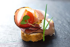 Slices of Bread with Spanish Serrano Ham Served as Tapas. Appetizer. Prosciutto Stock Images