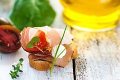 Slices of Bread with Spanish Serrano Ham Served as Tapas. Appetizer. Prosciutto Royalty Free Stock Images