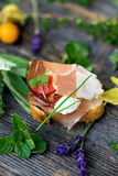 Slices of Bread with Spanish Serrano Ham Served as Tapas. Appetizer. Prosciutto Stock Photo