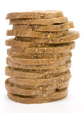 Slices of bread stack. Stack of cut granary bread on white background. Clipping path incl Stock Photo