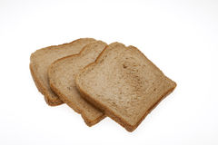 Slices of bread for toast. Slices of total milling bread for toast royalty free stock photography