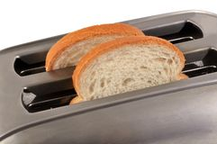 Slices of bread in a toaster stock images