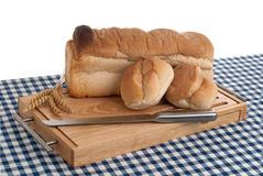 Slices of bread on top of wooden board Stock Images