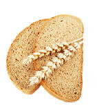 Slices of bread and wheat ears Royalty Free Stock Photo