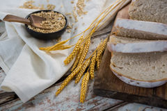 Slices of bread with wheat grains and oats Royalty Free Stock Image