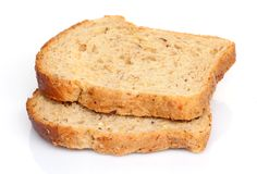 Slices of bread on white Stock Images