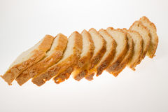 Slices of bread strung on white background Stock Images