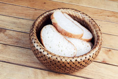Slices of bread in wicker basket Stock Photo