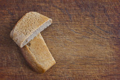 Slices of bread on the wooden background. Two slices of bread on the wooden background Royalty Free Stock Photography