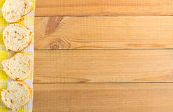 Slices of bread on yellow napkin from left side table Royalty Free Stock Images